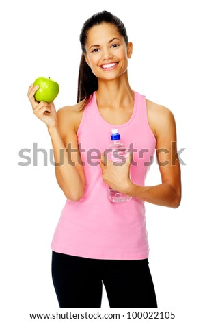 carefree healthy hispanic woman with apple and water smiling with cheerful confidence isolated on white - stock photo