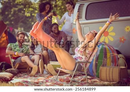 Carefree hipster having fun on campsite at a music festival - stock photo