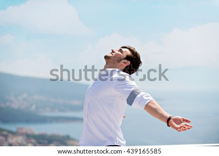 carefree outstretched arms - stock photo