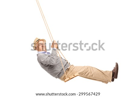 Carefree senior man swinging on a wooden swing and looking at the camera isolated on white background - stock photo