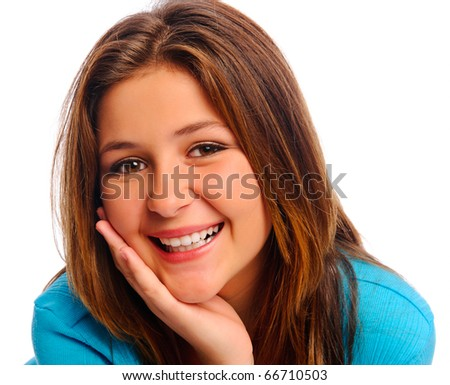 Carefree teenager smiles in studio, isolated on white - stock photo