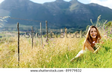 carefree vitality woman is happy outdoor in a field.  large panorama image with copyspace. - stock photo