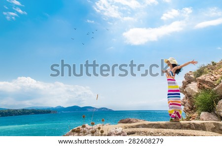 Carefree  woman profile breathing deep fresh air in summer on the beach. Copy space - copyspace. Girl with open arms. Freedom - wellbeing - stock photo