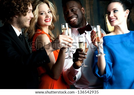 Carefree young couples having cocktails and partying together. - stock photo
