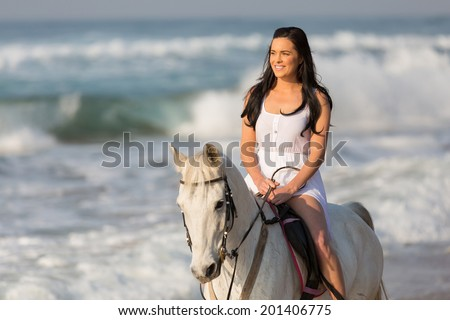 carefree young woman morning beach horse ride - stock photo