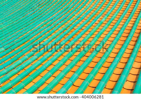 Carefully painted and patterned roof tiles atop a traditional, Chinese style Buddhist temple
