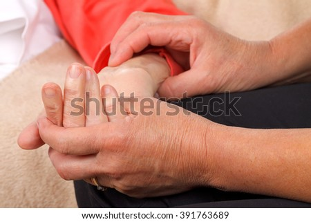 Caregiver checking patients blood pressure - stock photo