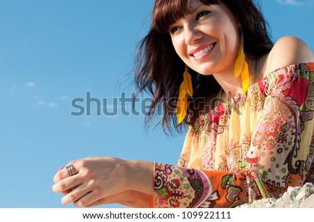 Careless summer: young caucasian woman relaxing outdoors - stock photo