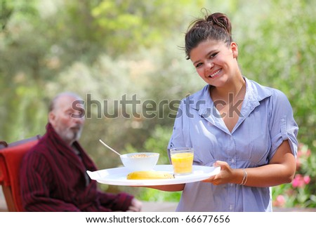 carer with senior patient - stock photo