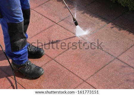 Caretaker with high-pressure cleaner - stock photo