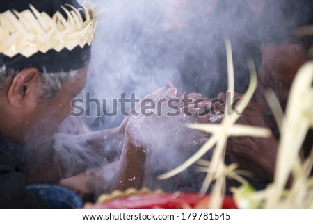 CAREY ISLAND, SELANGOR,MALAYSIA - MARCH 1, 2014 : Unidentified shaman of Mah Meri tribe shakes hand during Ari Moyang (Ancestors Day) celebration in Pulau Carey Island, Klang, Malaysia. - stock photo