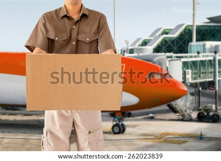 cargo aircraft for air parcel delivery service with plane on background - stock photo