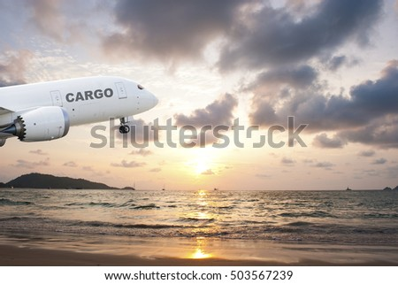 Cargo airplane taking off at sunset