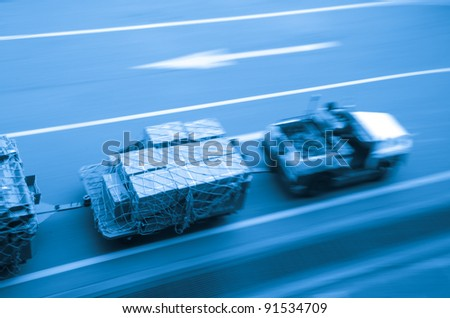 cargo car delivery on airport blur motion - stock photo