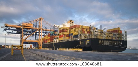 Cargo container ship in African port - stock photo