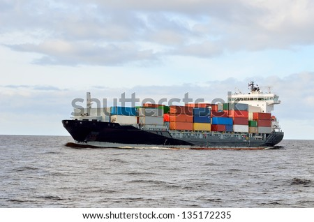 cargo container ship sailing - stock photo