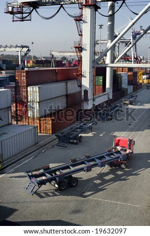 Cargo containers at the docks waiting for shipping out - stock photo