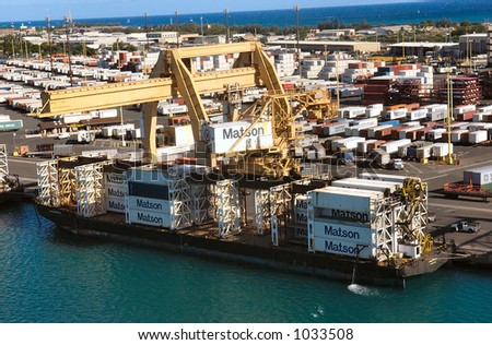 Cargo containers being loaded in Honolulu Harbor, Oahu Hawaii. - stock photo