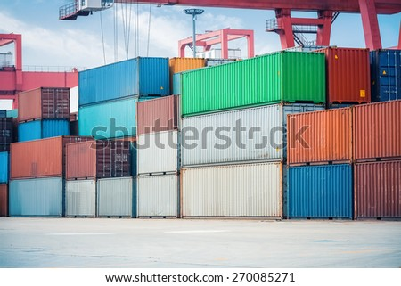 cargo containers closeup in storage area of freight port terminal - stock photo