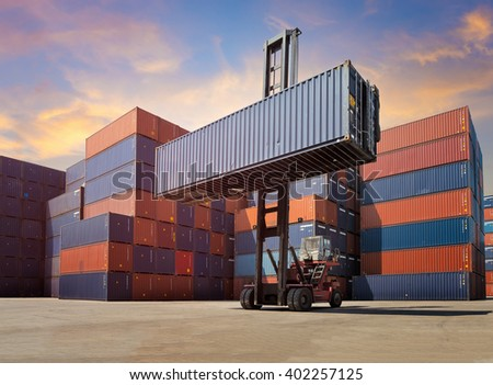 Cargo containers in shipping yard for import,export industrial against sunrise sky environment.
