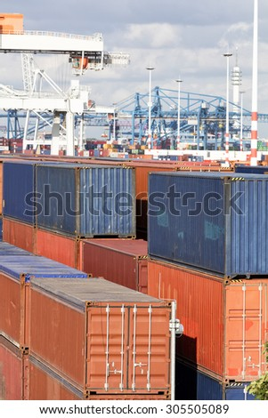 Cargo containers stacked at harbor