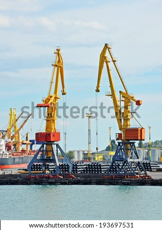 Cargo crane and steel wire roll, ready for shipment in port