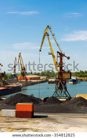 Cargo crane, freight traine and coal in port - stock photo