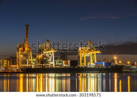 Cargo cranes at the port. - stock photo