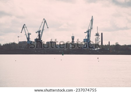 cargo dock and cargo ships in seaport in Riga. latvia - retro, vintage style look - stock photo