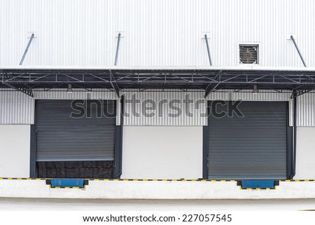 cargo doors at the warehouse building - stock photo