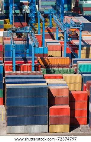 Cargo freight containers at the port awaiting shipment - stock photo
