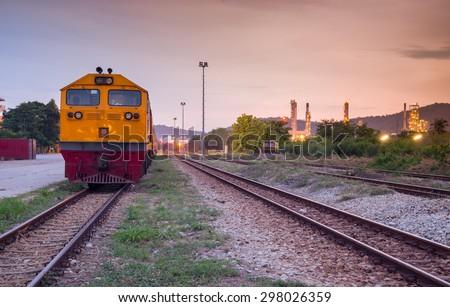 Cargo freight train railroad station at dusk - stock photo