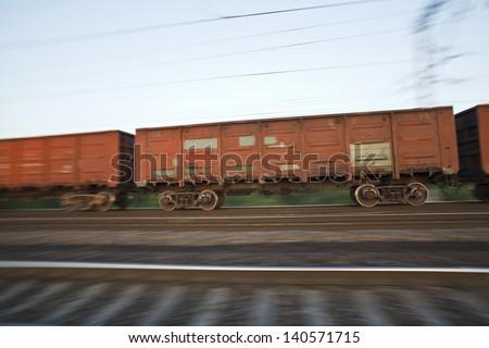 Cargo gondola cars of the moving cargo train - stock photo