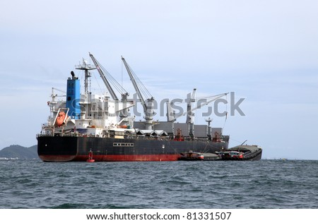 cargo liner freight Ship with containers and tug ship