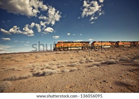Cargo locomotive railroad engine crossing Arizona desert wilderness - stock photo