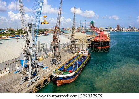 Cargo operations in the trading port in front of Dar es Salaam, Tanzania - stock photo