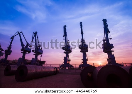 Cargo port in the evening,?The silhouette of gantry crane