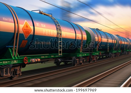 Cargo railway shipping industry and freight railroad transportation industrial concept: modern high speed train with petroleum tankcars on tracks with motion blur effect - stock photo