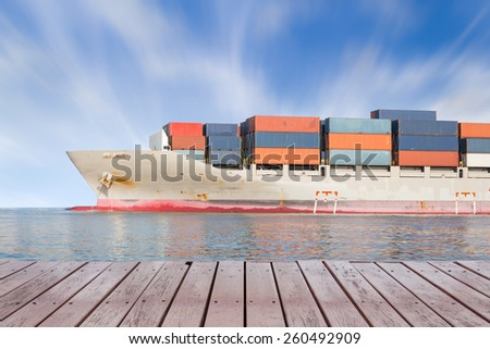 Cargo ship and cargo container in sea with clear sky background. - stock photo