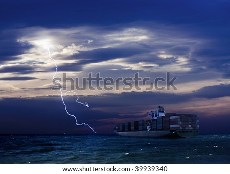 Cargo Ship and Lightning over sea with dark clouds - stock photo