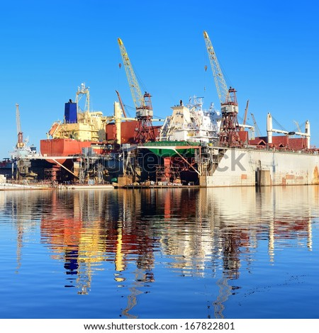 cargo ship are during fixing and painting at the shipyard docks - stock photo
