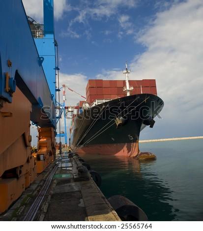 cargo ship at dock - stock photo