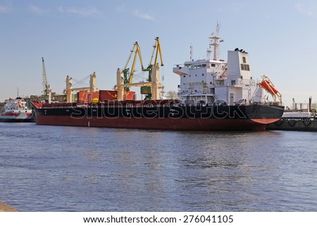 cargo ship berthed at the port - stock photo