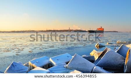 Cargo ship (Bulk carrier) sailing out of the port. Riga, Latvia - stock photo