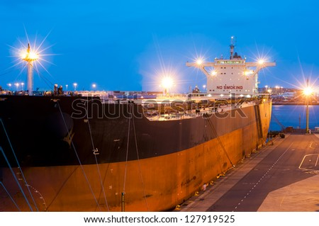 Cargo ship by night - stock photo