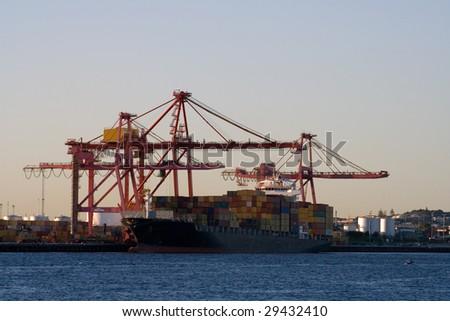 Cargo Ship Docked at Port - stock photo