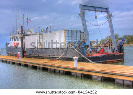 Cargo Ship docked waiting out a passing storm - stock photo