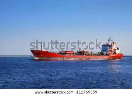 Cargo ship entering port of Riga - stock photo