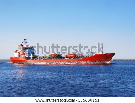 Cargo ship entering port of Riga - stock photo