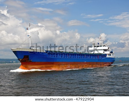 Cargo ship entering the port of Gdansk, Poland. - stock photo
